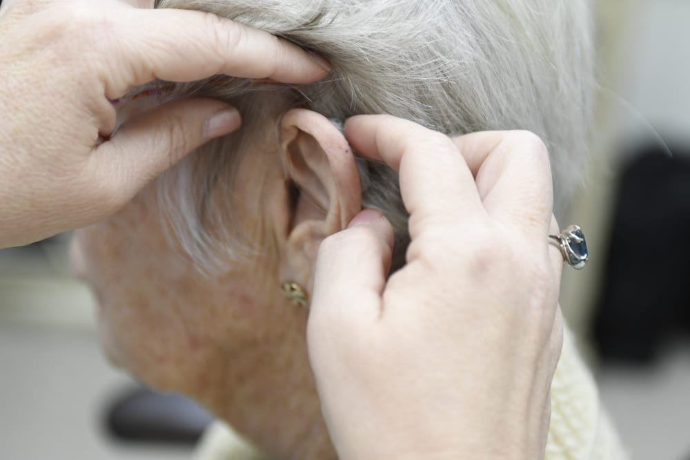 Hearing Aid being fitted by Audiologist at Aim Hearing